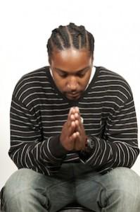 black-man-praying-for-community